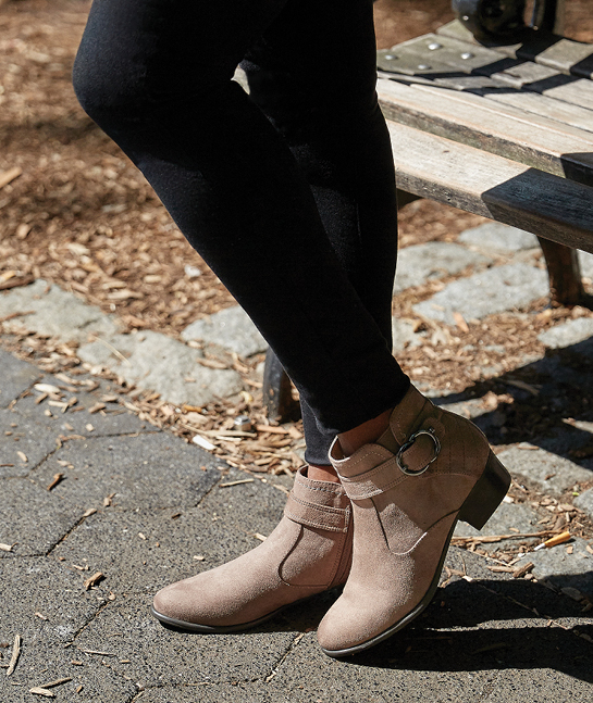 Woman's legs wearing Unisa booties.