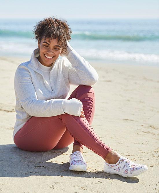 Woman sitting on a beach.