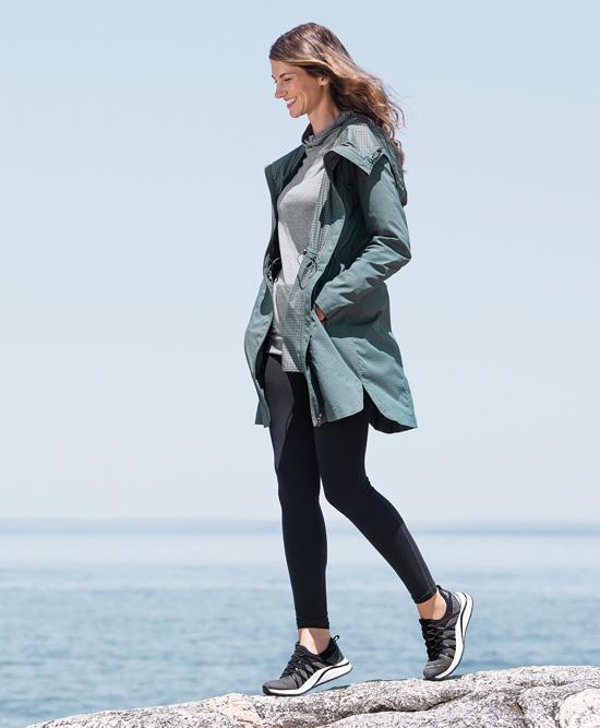 Woman walking on beach wearing Easy Spirit.