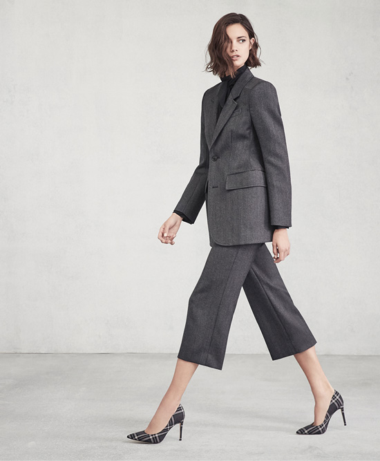 Woman in modern suit wearing Marc Fisher LTD.