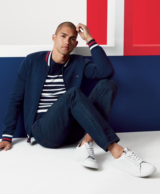 Man sitting down, wearing Tommy Hilfiger shoes.