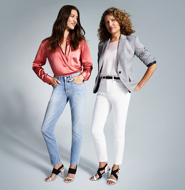 Two women wearing black and white Nine West heels.