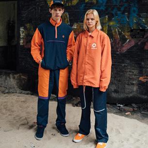Two people standing in Airwalks.